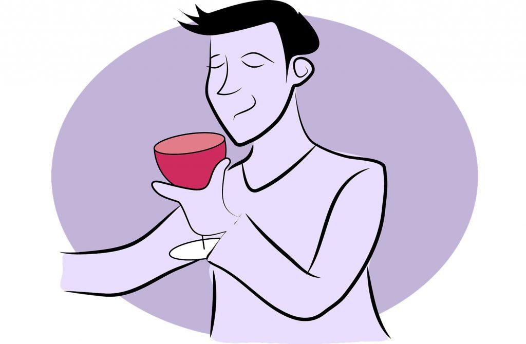 Persona tomando una copa de vino